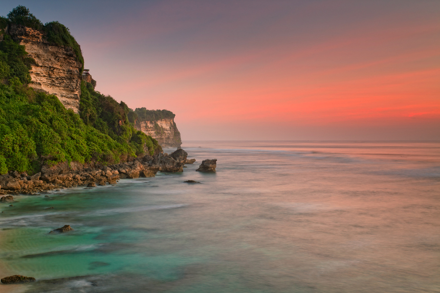Bali beach cliff at sunset - Mari Bali Tours