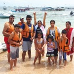 family group from India at water sport beach - Mari Bali Tours