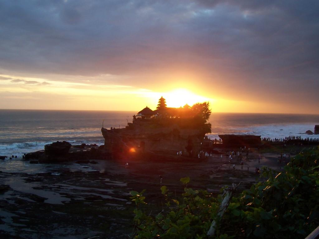 The wonderful Tanah Lot temple at beautiful stunning looks in sunset view in Beraban village,Tabanan regency, Bali island - Mari Bali Tours