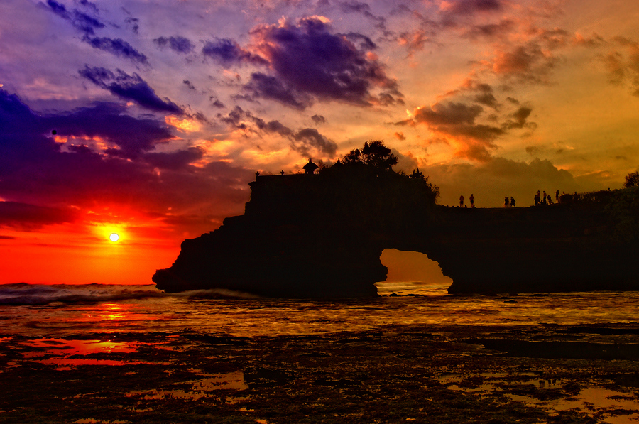 Batu Bolong temple in tanah lot temple area at stunning sunset view, Bali island, Indonesia - Mari Bali Tours