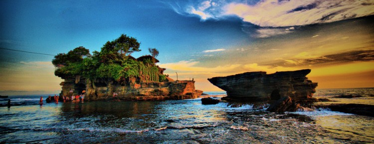 The wonderful Tanah Lot temple at beautiful stunning looks in sunset view in Beraban village,Tabanan regency, Bali island - Mari Bali Tours